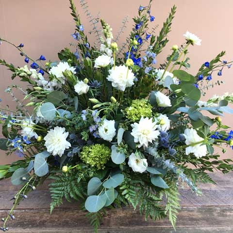 Blue and White Funeral Flower Arrangement